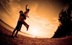 Playful-Couple-On-The-Beach-1