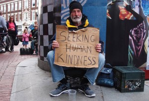 man with sign seeking human kindness